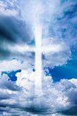 Cross In The Cloudy Sky