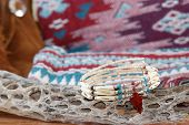 picture of chokers  - Handcrafted bead and bone Native American Choker Necklace in Southwester Still Life setting with Indian Blanket Moccasins and an old stick of dried cholla cactus - JPG