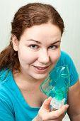 Woman In Medical Inhalation Mask Breathing