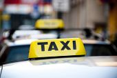 picture of cabs  - taxi cabs sign on top of car - JPG