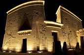 stock photo of isis  - Main entrance to the Temple of Isis on Philae Island in Aswan at night - JPG
