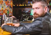 Brutal Hipster Bearded Man Sit At Bar Counter Drink Beer. Friday Evening. Bar Is Relaxing Place To H poster