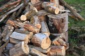 Natural Wood Background - Closeup Of Chopped Firewood. Firewood Stacked And Prepared For Winter. A P poster