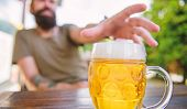 Distinct Beer Culture. Mug Cold Fresh Beer On Table Close Up. Man Sit Cafe Terrace Enjoying Beer Def poster