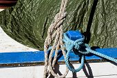 Cleat With Blue And White Rope. Small Blue Cleat With Blue And White Rope For Ships And Boats. Blue  poster