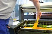 Printing. Printing Machine. The Printer Applies Ink Inks. The Printing Process. poster
