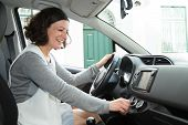 Cheerful Car Driver Using Climate Control. Happy Young Woman Ready To Drive. Commuting Concept poster