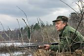 foto of duck-hunting  - The hunter has noticed flying up wild ducks - JPG