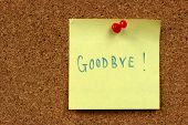 image of goodbye  - Yellow small sticky note on an office cork bulletin board - JPG
