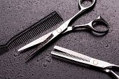 Scissors And A Hairdresser Comb In Drops Of Water On A Dark Background. Barber Scissors Close Up. Sc poster