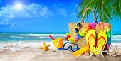 Tropical beach with sunbathing accessories, summer holiday background. Travel and beach family vacat poster