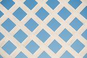 White lattice board against blue sky
