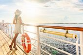 Luxury cruise ship travel elegant tourist woman watching sunset on balcony deck of Europe mediterran poster