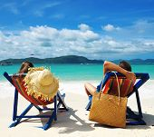 image of couple sitting beach  - Couple on a tropical beach - JPG