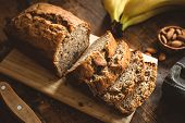 Banana Bread Loaf Sliced On Wooden Table. Wholegrain Banana Cake With Nuts poster