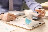 Financial Inspector Report Calculating Balance. Internal Revenue Service Worker Checking Document. A poster