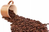 Blurred Coffee Cup And Roasted Coffee Beans Isolated On White