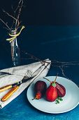 Pears In Wine. Traditional Dessert Pears Stewed In Red Wine With Chocolate Sauce On Plate On Blue Co poster