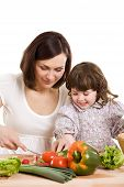 Mother And Daughter Cooking At The Kitchen poster