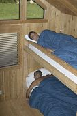 Men sleeping in bunk beds