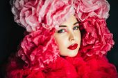 Close Up Portrait Of Beautiful Young Model With Bright Fashion Makeup, Wearing Big Pink Fluffy Colla poster