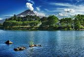 Mighty volcano Mount Fuji is seen from the lake Kawaguchiko. Summer photo
