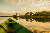 Beautiful Sunrise On The River. View From The Boat At Amazon River, With A Dense Forest On The Shore poster