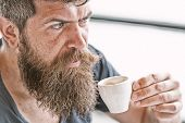 Enjoy Hot Drink. Hipster Drinking Coffee Outdoor. Man With Beard And Mustache And Cup Of Coffee. Bea poster