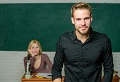 Man Well Groomed Attractive Teacher In Front Of Classroom. Obsessed With Knowledge. Teacher Of Her D poster