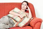 Woman On Sofa Having Headache