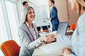 Business Shaking Hand With A Client In Office poster