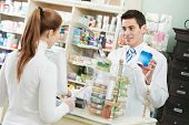 pharmacist suggesting medical drug to buyer in pharmacy drugstore