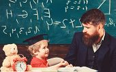 Kid Happy Studies Individually With Teacher, At Home. Individual Schooling Concept. Father With Bear poster