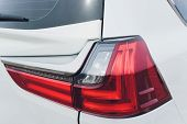 Close Up Of Rear Lights Detail Of Modern Luxury Car With Projector Lens For Low And High Beam. Front poster