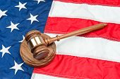 foto of inference  - A gavel and sound block on an American flag representing the legal system and any law inference in the USA - JPG