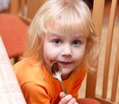 Small girl eating her chocolate