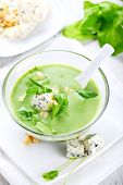 Soup with spinach, pine nuts and gorgonzola