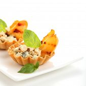 Appetizer with peaches, gorgonzola and almonds