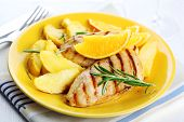Chicken with fresh rosemary and baked apples with orange juice and sider