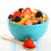 Bowl of granola with fresh berry isolated on white background