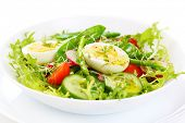salad of tomatoes, cucumbers, asparagus, young green peas dressed with olive oil and watercress sala