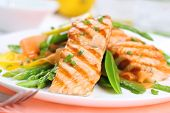 stock photo of plate fish food  - grilled salmon with spring vegetables on white plate - JPG