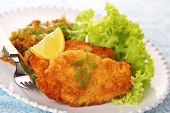 foto of wieners  - Wiener Schnitzel on white plate with salad and lemon - JPG