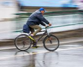 Cyclist On The City Roadway In Motion Blur poster