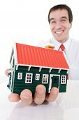 Ecstatic Businessman With A Miniature House