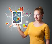 beutiful woman holding modern tablet with colorful diagrams and graphs