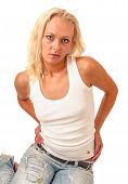 Sullen Girl Dressed In A White Tank Top And Worn Jeans