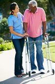 stock photo of independent woman  - Carer Helping Senior Man With Walking Frame - JPG