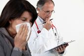 Doctor diagnosing a patient