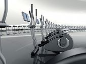 picture of elliptical  - Futuristic huge curved modern gym with many elliptical cross trainer in a row - JPG